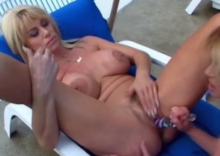 Dirty lesbian mommies eat pussy outdoors