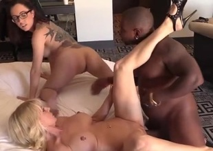 Hot milf and a cute gal take turns with darksome cock