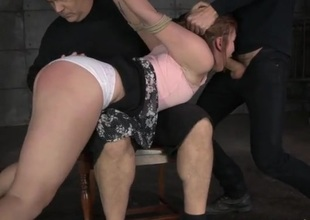 Ravishing looking girl in bondage gets spanked and face fucked