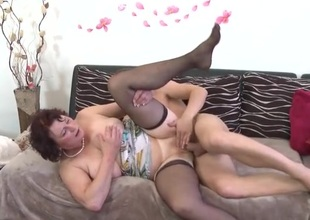 Unfurnished mature cookie banged by a young dick