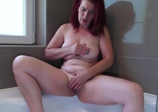 Large booty doyen redhead rubs her hot holes