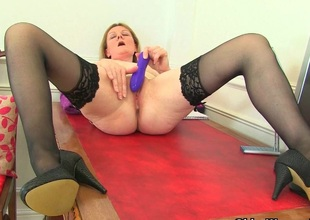 British milf Clare strips off her secretary outfit with the addition of plays