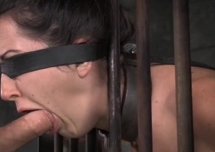 Manacled depending in a cage opens her mouth be beneficial to outlook fucking