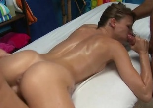 Masseurs double round out the oiled up cutie