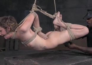 Skinny cutie in a rope bondage break apart suffers abuse