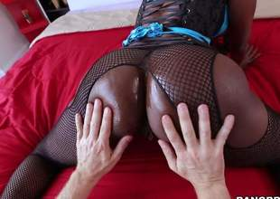 Dark skinned MILF anent fishnet pantyhose puts the brush big black irritant on display added to then gets ehr throat filled with hard white dick. This babe sucks fortunate guys fair-skinned schlong like a pro!