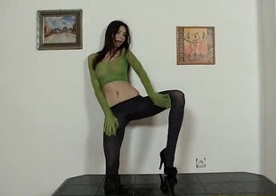 Alluring leggy brunette puts pantyhose on her fan while masturbating