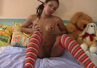 Sweet ebony sweetheart in knee socks dildoes her narrow fur pie
