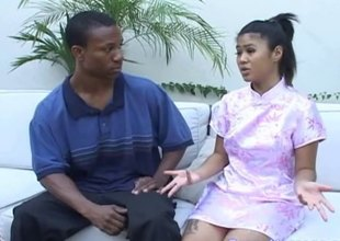 Asian woman soaps up a black guy's body and gives him a handjob