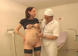 Irregular doctor examines bald-pated pussy of one young chick Vika wearing hawt stockings