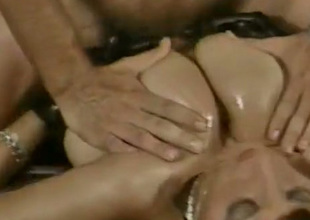 Bewitching temptress approximately stupendous juggs lets her lover titty fuck her