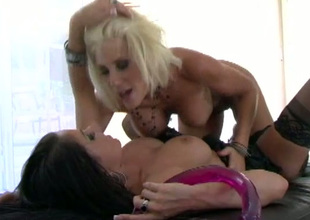 Double ended dildo helps lusty PUMA and SAVANNAH STERN reach orgasm