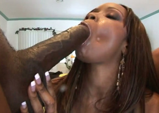 Chesty black chick in knee overweening boots worships two big cocks like a boss