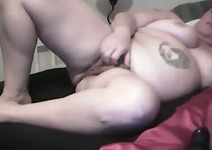 My fat tattooed wife toys her cunt to turning-point indoors