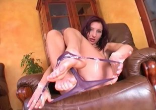 Forlorn solo model slides a monster dildo up her cunt close up