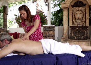 Brunette masseuse gives her well-known client special treatment
