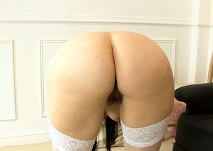 Chubby dark brown in stockings plays with will not hear of hairy muff's broken up
