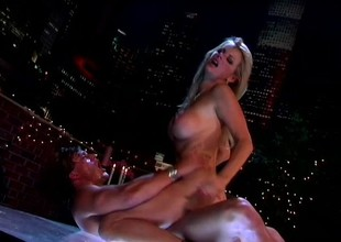 Busty blond bimbo enjoys a FMM threesome by the city lights