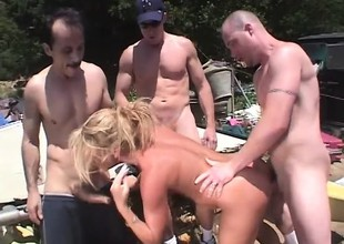 Wicked blonde milf Chelsea Zinn has two guys banging her holes outside