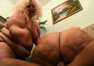 2 fat golden-haired strumpets prevalent turns riding on a chunky chaser's dig up