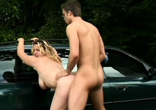 Sexy Sophie Von Tramp leans over a car for some brutal screwing