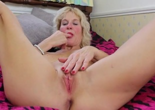 Blonde mom with a blazing hot body fingers her pussy