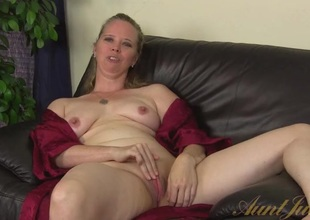 Milf opens her robe and plays with her clit