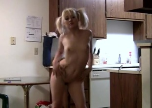Adorable skinny blonde in pigtails dances for the camera