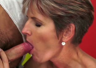 Slutty cougar Lannie gives head added to then fucks missionary breath