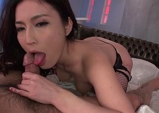 Gorgeous Japanese babe in fishnets rides a dick