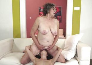 Venerable woman gets finger screwed by sexy brunette