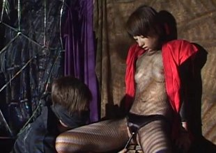 In a dungeon a Japanese tolerant gets her wet slit filled with toys