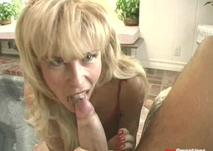 Blonde MILF is thrilled to be sucking on a man's chubby large dick