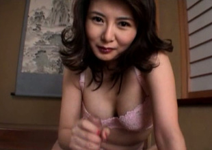 Cute buxom and horny Japanese MILF jacks off gumshoe with joy on the stagger
