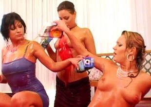 Alluring babes at a hotel engage in a wringing wet and captivating juice fight
