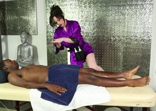 Pale skinned masseuse sucking a menacing dude's cock on along to massage embark on