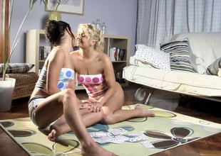 Lesbian sex dolls setting up out in the lead fucking with a strap on dildo