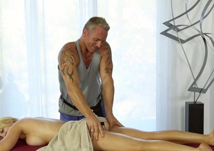 Busty golden-haired gets intimate respecting the horny masseur