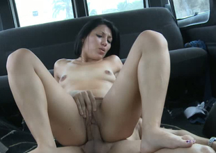 Sultry bitch riding steadfast ramrod on top in a van