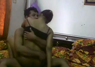 Dusky skin Desi hot wife rides the brush husband on camera