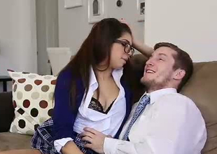 Brunette college bettor in sexy glasses is fed encircling a dick