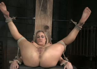 Curvy whore Angel Allwood is roiled toy fucked in BDSM porn clip