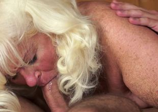A corpulent old chick is screwed in the sauna by a big young stallion