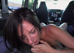 A brunette non-professional is getting cumshot in the back of a car