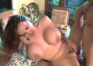Huge breasted redhead mom bounces on a throbbing prick with excitement