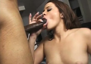 Frisky brunette is desirous to take in this hunk's unyielding darkling dong