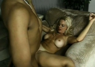 Hot blond babe gets a hanker darksome cock to eat and pound her muff