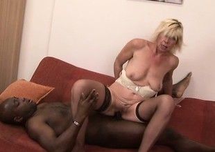 Sassy blonde MILF in stockings bends over be advisable for some big blackguardly penis
