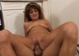 A feisty MILF is mainly the position hung young dudes to bone her twat