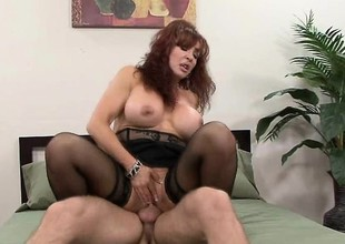 Mature redhead at hand a grand couple of knockers gets a shafting